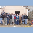 thumbnail The group that built the first house.